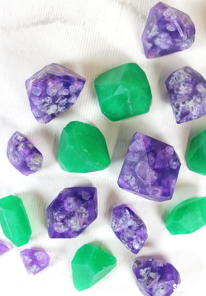 Learn how to make soap gems in this easy video tutorial! Post includes two different techniques to make soap emeralds and amethysts.