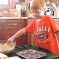 Jamisen is helping with Quinoa Stuffing Muffins