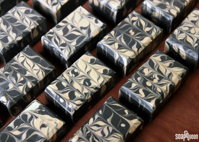 Learn how to make this Charcoal & Cedar Beer Cold Process Soap. It's scented with a natural blend of essential oils, and uses all natural colorants to create a beautiful contrasting swirl.