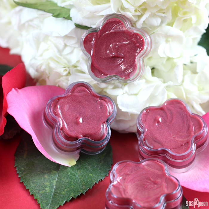 This Rosy Red Lip Gloss is made with jojoba oil and castor oil to create a luxurious, glossy product.