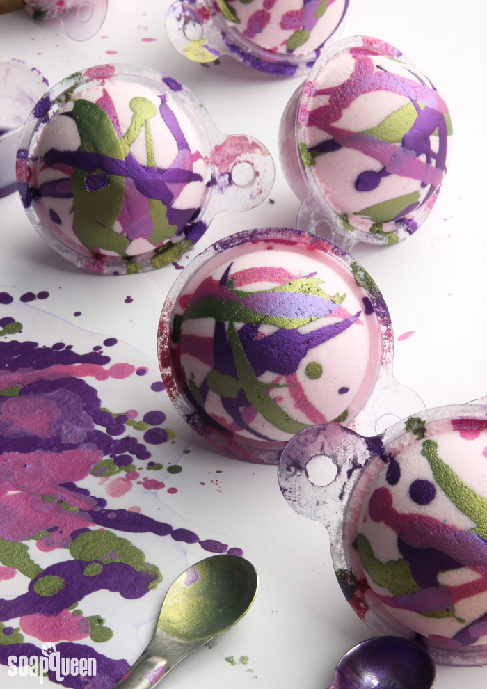 "Painted Berry Bath Bomb DIY. These bath bombs are ""painted"" with a mixture of mica and alcohol for a fun splatter effect."
