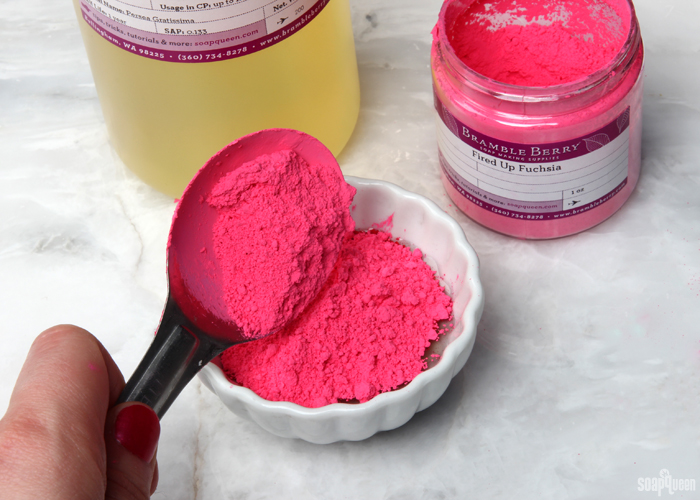Neon Pink Lip Tint Tutorial /// Learn how to make lip tint using cocoa butter, beeswax and avocado oil.