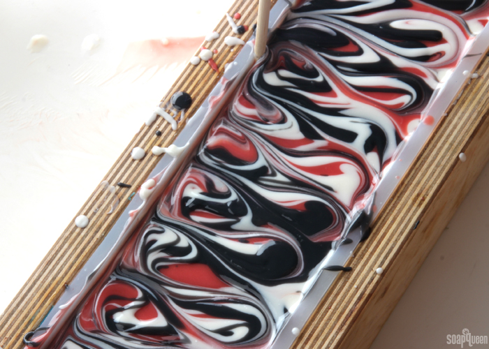 Red Hanger Swirl Cold Process Soap Tutorial // Learn how to create this bold and dramatic soap!